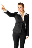 Smiling business woman touching abstract screen Stock Images