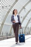 Smiling business woman traveling with bag Stock Photography