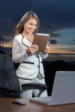 Smiling business woman using digital tablet on the office Stock Photo