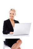 Smiling business woman using laptop computer Stock Image