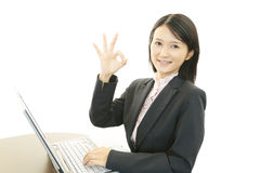 Smiling business woman using laptop Royalty Free Stock Photos
