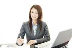 Smiling business woman using laptop Royalty Free Stock Images