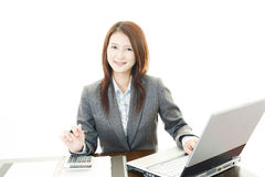 Smiling business woman using laptop Royalty Free Stock Photo