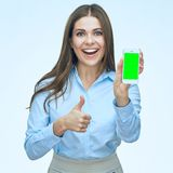 Smiling business woman using mobile phone show thumb up. Isolated portrait. Long hair Royalty Free Stock Images
