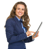 Smiling business woman using tablet pc Royalty Free Stock Image