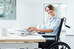 Smiling business woman in wheelchair royalty free stock images