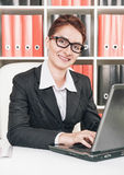 Smiling business woman working Stock Photos
