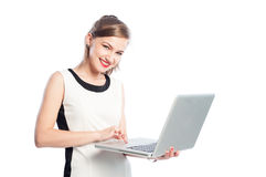 Smiling business woman working on laptop Stock Image