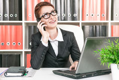 Smiling business woman working Stock Image