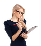 Smiling business woman writing on clipboard Royalty Free Stock Photo