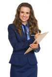 Smiling business woman writing in clipboard Stock Photos