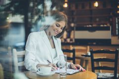 Sign document. Smiling business woman writing on document royalty free stock images