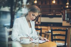 Work with document. Smiling business woman writing on document stock photos
