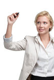 Smiling business woman writing on the invisible screen Royalty Free Stock Image
