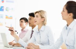 Business woman with colleagues in meeting room royalty free stock photography