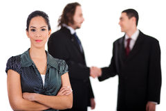Smiling business women in focus with two business Royalty Free Stock Images
