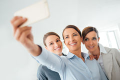Smiling business women team taking a selfie Stock Photography