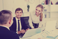 Smiling business workers holding documents Stock Photo