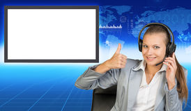 Smiling businesslady in chair and earphones Royalty Free Stock Photos