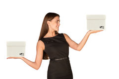 Smiling businesslady holding two white boxes Stock Photo