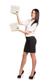 Smiling businesslady holding two white boxes Royalty Free Stock Image