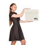 Smiling businesslady holding white box Stock Image