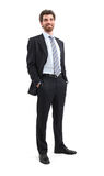 Smiling Businessman. Young businessman is standing and looking away with his hands in his pockets. Isolated on white background Stock Photo