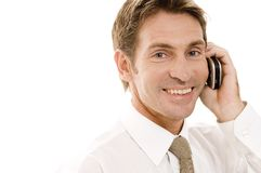 Smiling Businessman. A happy businessman talking on a phone Stock Photos