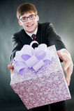 Smiling businessman. With gift box Royalty Free Stock Photos