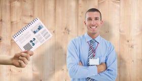 Composite image of smiling businessman. Smiling businessman against wooden planks Stock Photo