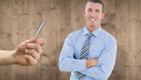 Composite image of smiling businessman. Smiling businessman against wooden planks Stock Photos