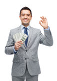 Smiling businessman with american dollar money Stock Photos
