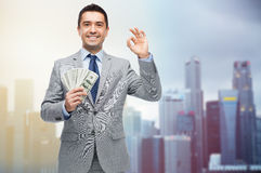 Smiling businessman with american dollar money Stock Photography