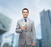 Smiling businessman with american dollar money Royalty Free Stock Photos