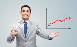 Smiling businessman with american dollar money Royalty Free Stock Image