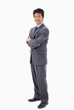 A smiling businessman with the arms crossed Royalty Free Stock Photos