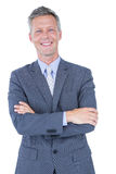 Smiling businessman with arms crossed Royalty Free Stock Photos