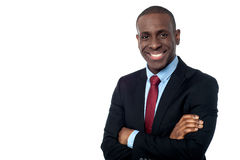 Smiling businessman with arms crossed royalty free stock photography