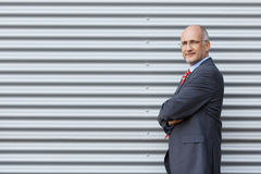 Smiling Businessman With Arms Crossed Royalty Free Stock Photo