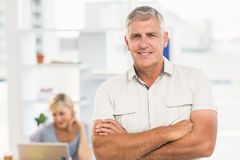 Smiling businessman with arms crossed Stock Photos