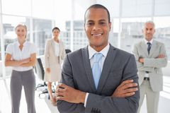 Smiling businessman with arms crossed Stock Photography