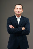 Smiling businessman with arms folded Royalty Free Stock Image
