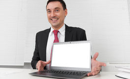 Smiling businessman with blank laptop screen Stock Images