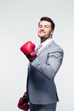 Smiling businessman in boxing gloves Stock Photos