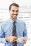 Smiling businessman during break time in office Stock Photo