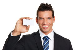 Smiling businessman with business card Stock Image
