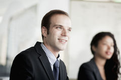 Smiling businessman at a business meeting Stock Images