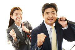Smiling businessman and businesswoman Royalty Free Stock Photography
