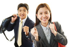 Smiling businessman and businesswoman Royalty Free Stock Image