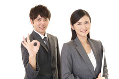 Smiling businessman and businesswoman Royalty Free Stock Images
